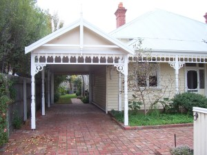 Tandem gable carport with traditional detailing by Outside Concepts