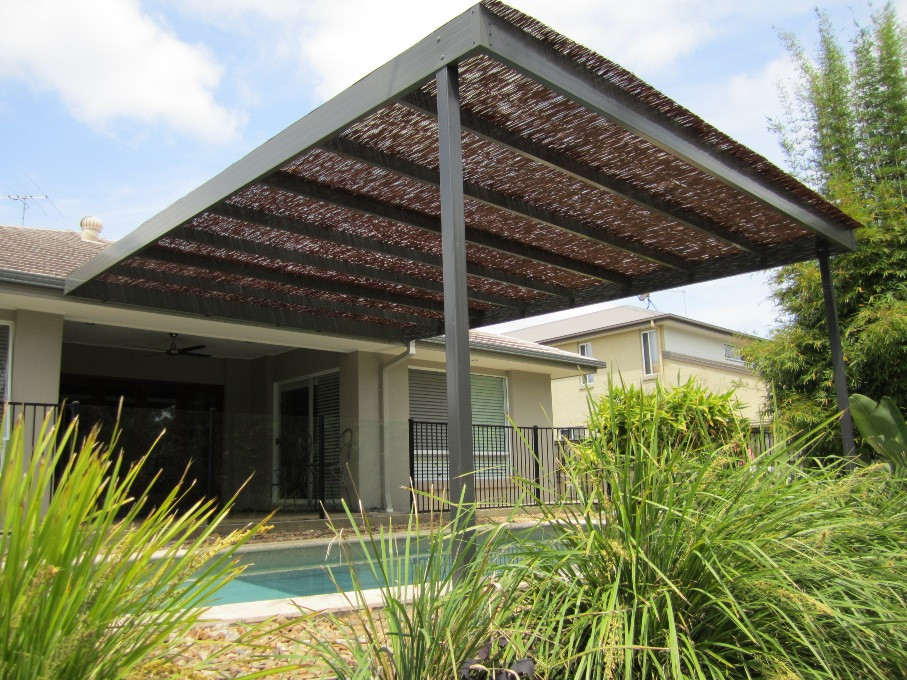 Pool Patio With Bamboo Awning For Filtered Shade