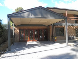 Lined gable carport with tiled roof by Outside Concepts North East
