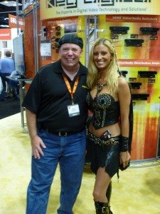 "David And A ""Booth Babe"" At The Trade Show"