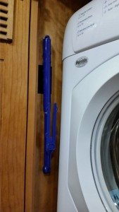 Duster Stored Next To Washer