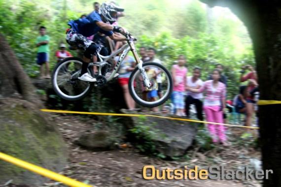 Downhill racer jumps a drop again
