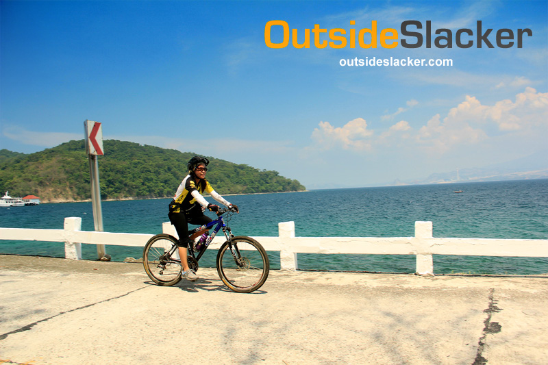 Biking along a coastal road in Corregidor