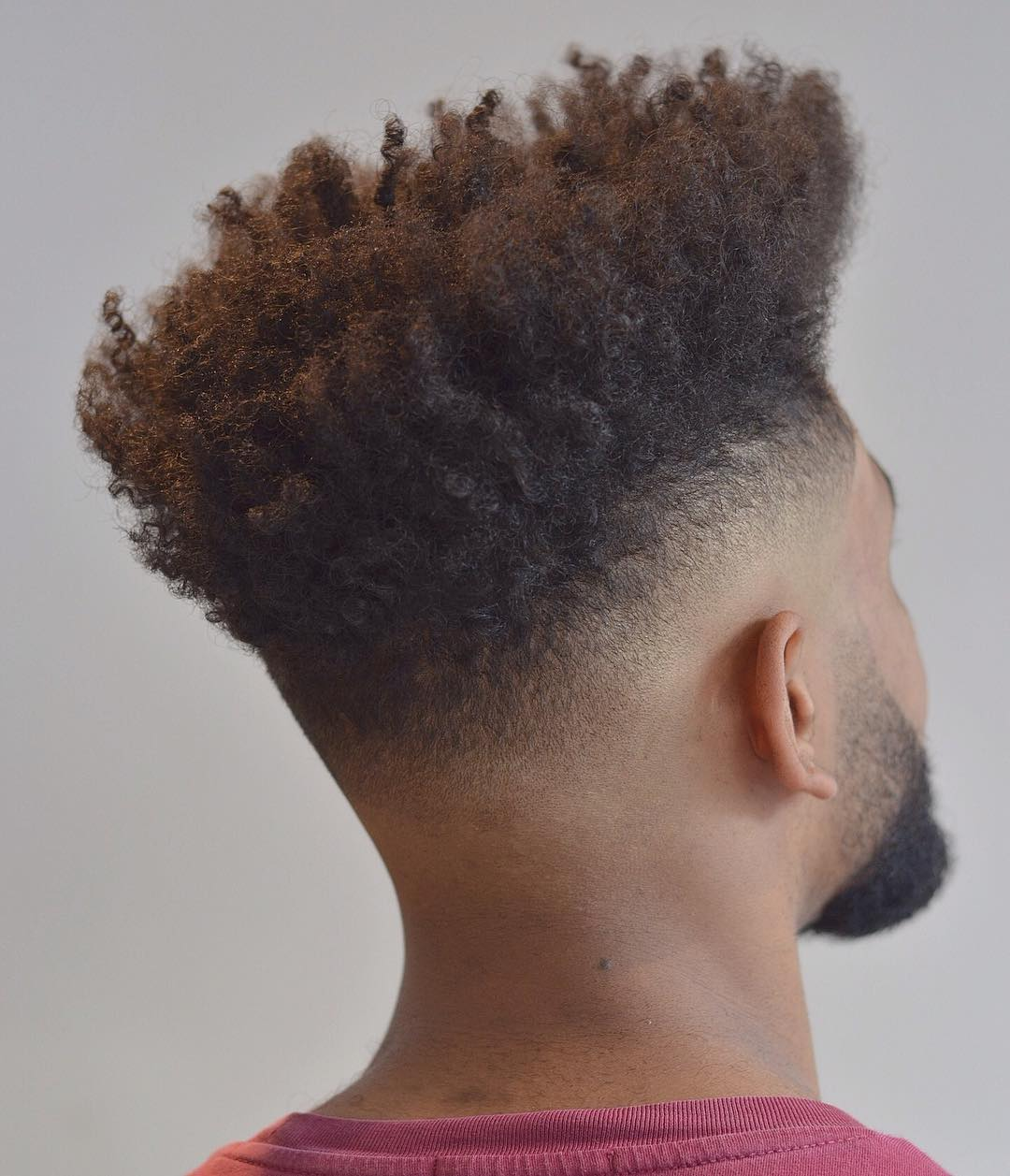 High fade with afro curls