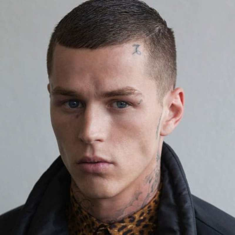 Tattooed man with Low Buzzcut with Short Sides