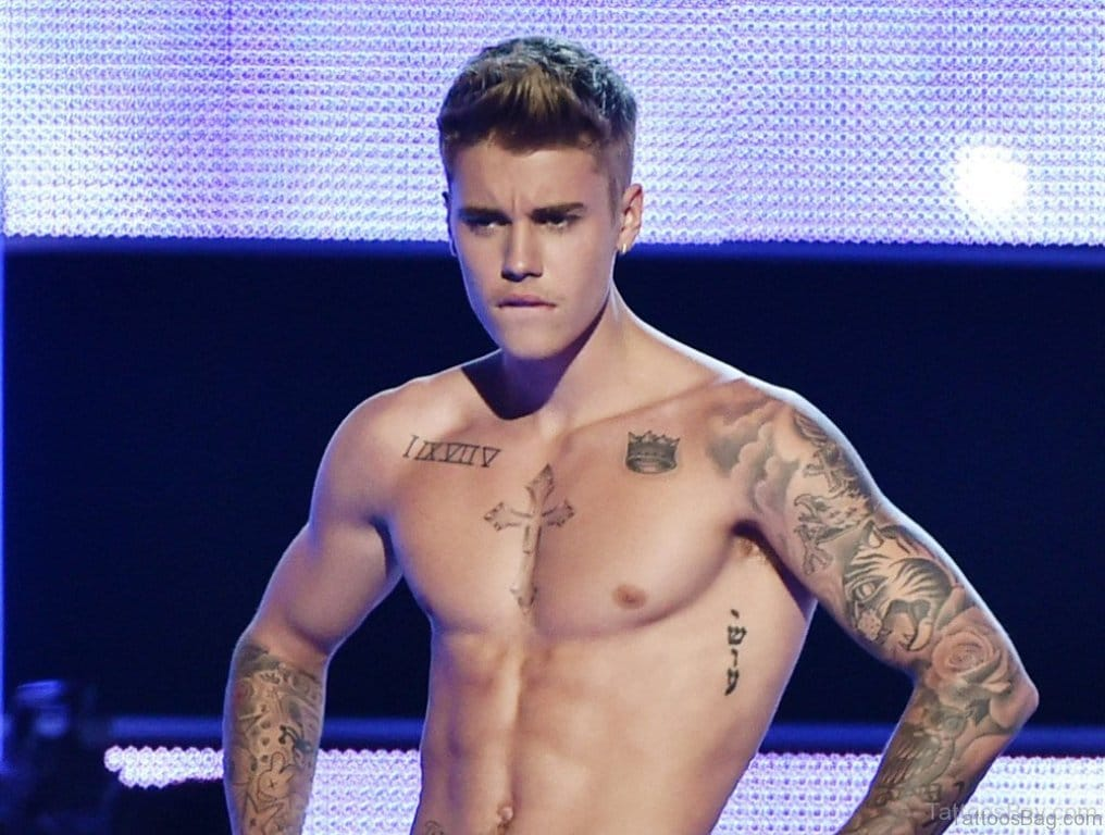 Justin Bieber topless with Cross Tattoo