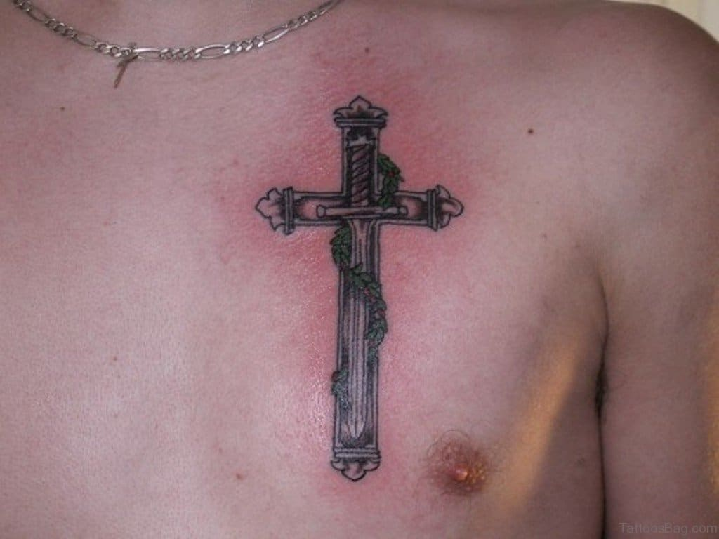 Sword in the middle of cross tattoo