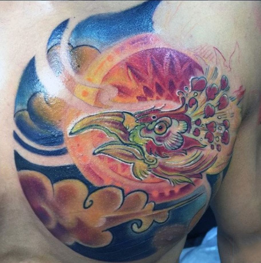 Amazing Coloured Mens Chest Tattoo