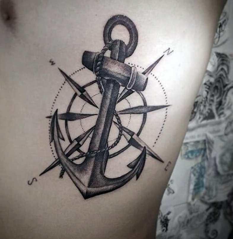Compass Rib Tattoo