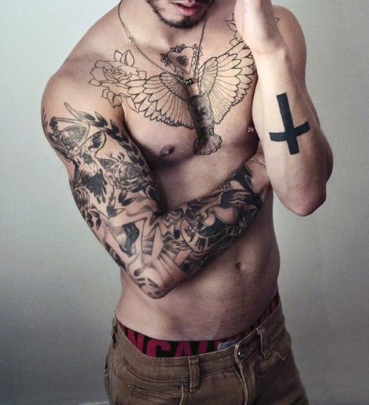 Bold Cross Arm Tattoo