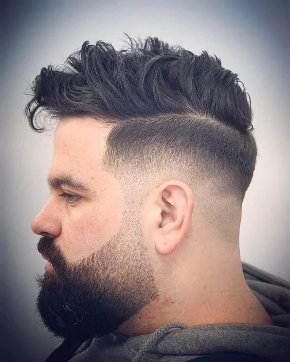 Medium Low Fade with Part and Faded Full Beard