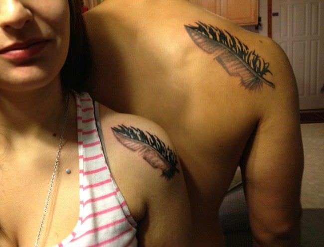 Couples Feather Tattoos on a shoulder