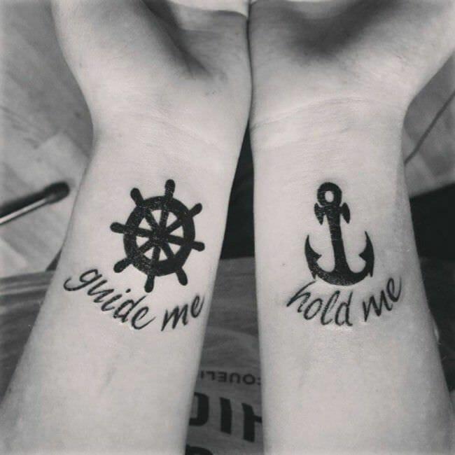 wheel & anchor arm tattoos