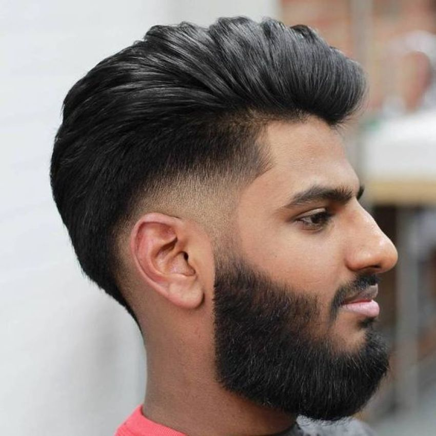 Medium Side Swept Low Fade Pompadour with thick Full Beard