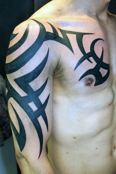 Cool Old School Tribal Arm & Chest Tattoo