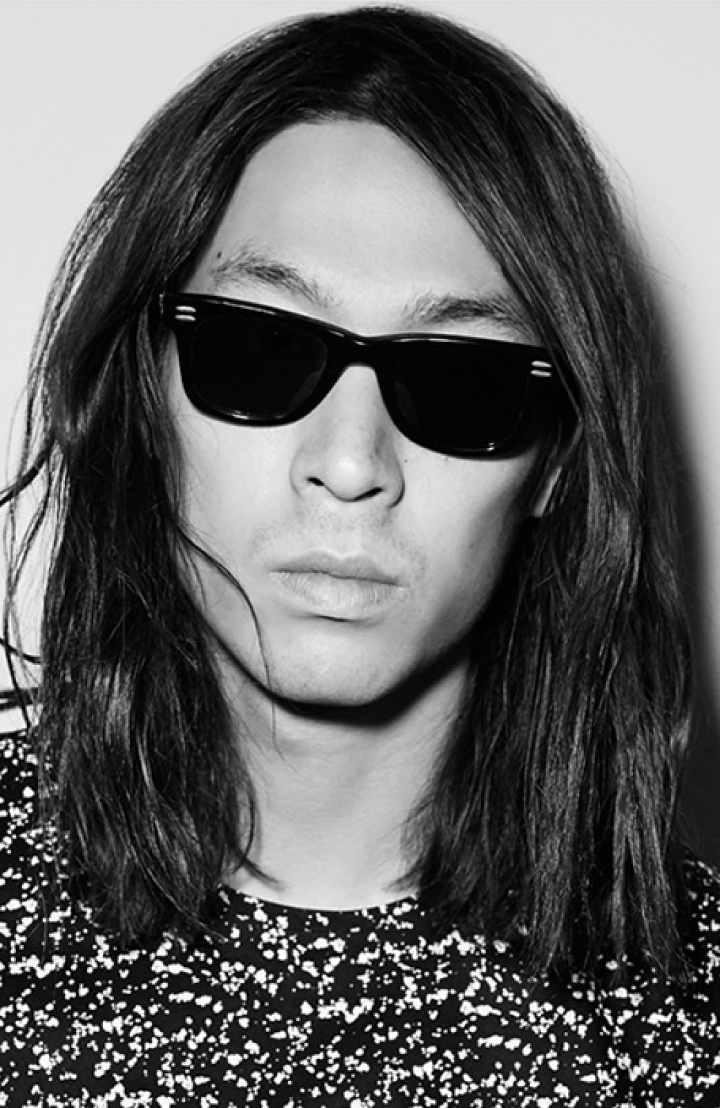 Kooples Model in black sunglasses and long black hair