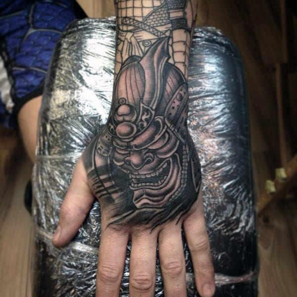 Mask Hand Tattoo