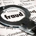 Fraud news articles under handcuffs