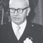 9. Wie was deze man en bij welke organisatie was hij bekend als voorzitter?