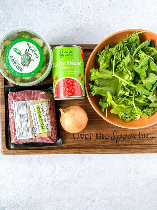 ingredients for a bunless burger on a wooden platter
