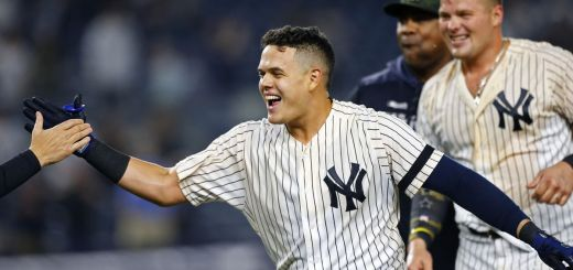 Gio Urshela celebrates with his teammates. His breakout year is helping the Yankees to a playoff spot