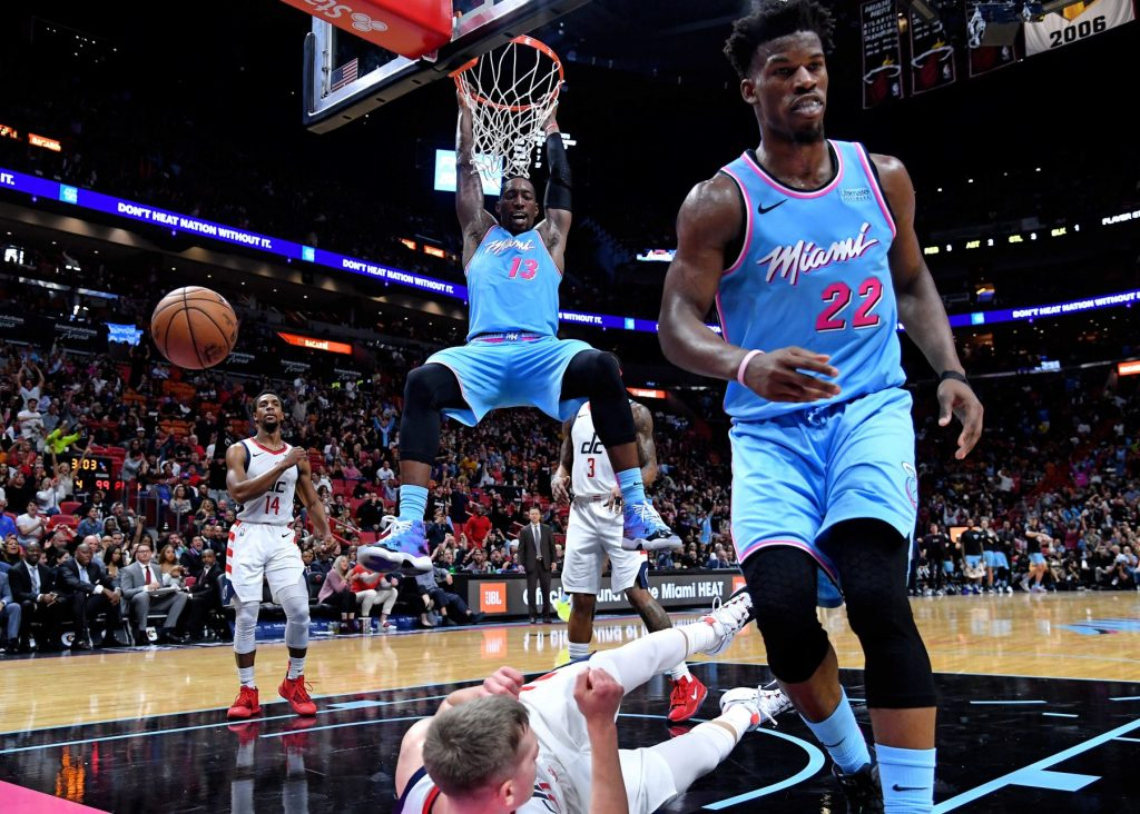 Bam and Butler, who should represent the Miami Heat front-court in the all-star game celebrating  a dunk against the Wizards