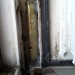 Badly damaged and very rusted old hinge