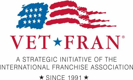 "A stylized American flag logo appears over the text ""VetFran. A strategic initiative of the International Franchise Association since 1991."""