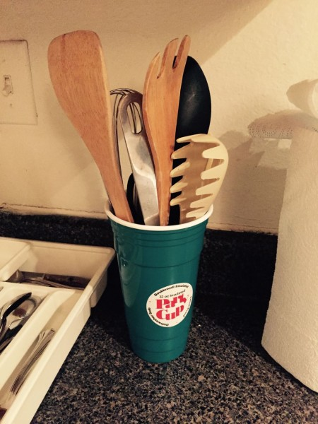 "This is the utensil caddy in our younger son's apartment, so I guess now it's a family tradition?  Also, never send your husband into Walmart to buy a utensil caddy. Especially if you tell him it's for spatulas and big spoons, and ""kind of like a big cup."""