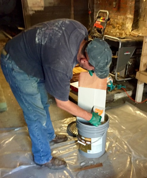 Before we hammer the shingles into place, they get the dip-and-stroke treatment. It's so time-consuming!