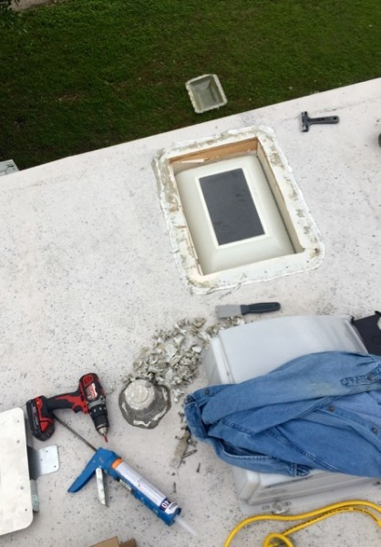 It's kind of a skylight-within-skylight deal. The interior one just needed a quick cleaning and re-taping. The exterior one was pried off and flipped to the ground below.