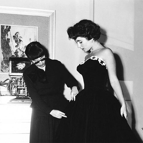 Edith Head with Elizabeth Taylor dressing her for A Place In The Sun