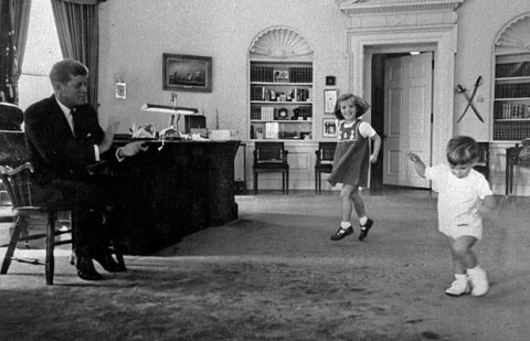 John F Kennedy watching his children dancing in the White House. Pluto in Cancer.