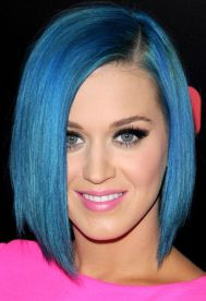 Popster Katy Perry (2012) has done blue a few times as well as lilac at least once.