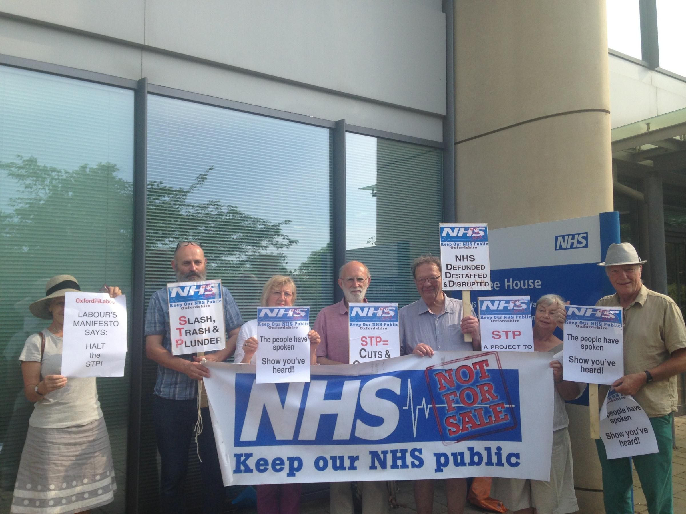 Members of campaign group Keep Our NHS Public are demanded the CCG's plans are halted and not split into two phases