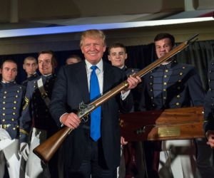 Donald Trump holding a gun for inauguration