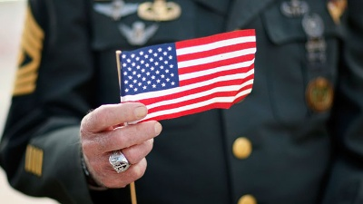 Veteran-holding-American-flag--Veterans-Day_20161111160548-159532