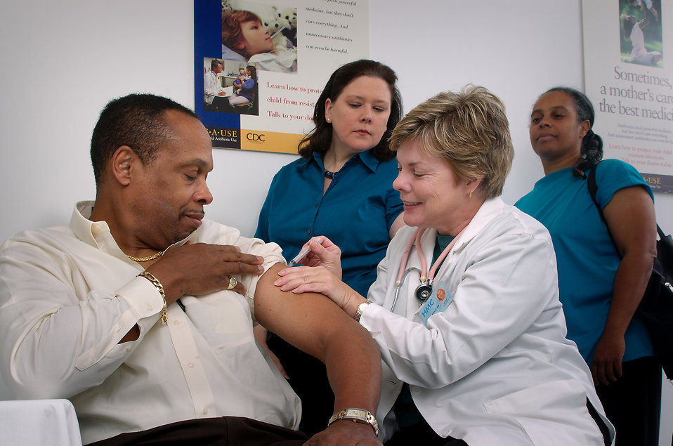 16732-a-nurse-giving-a-middle-aged-man-a-vaccination-shot-pv_1559253971110.jpg