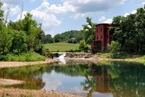 Photograph of the mill pond and mill at Dillard Mill, Missouri