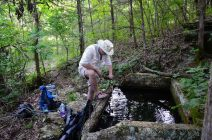 Photograph of Gary Allman filtering water using an MSR Sweetwater filter at Siloam Spring, Piney Creek Wilderness, Missouri