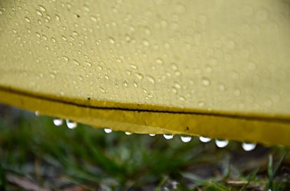 Rain collecting along the edge of a tent's flysheet