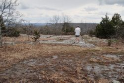 Gary standing near the top of Bell Mountain looking over the valley of Shut-In Creek.