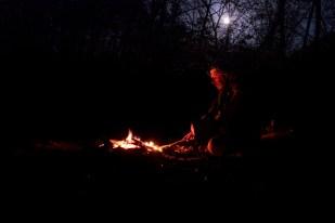 Gary tending the campfire.