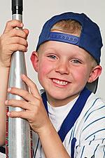 Boy with baseball bat.