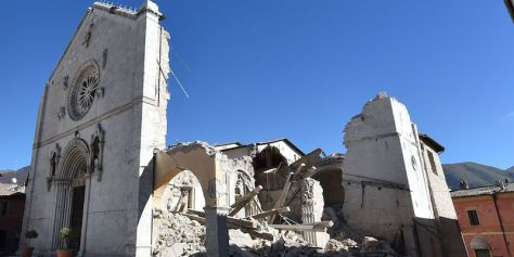 A picture shows the destroyed Basilica of St Benedict in the historic center of Norcia, on October 31, 2016, a day after a 6.6 magnitude earthquake hit central Italy. It came four days after quakes of 5.5 and 6.1 magnitude hit the same area and nine weeks after nearly 300 people died in an August 24 quake that devastated the tourist town of Amatrice at the peak of the holiday season. Italy's most powerful earthquake in 36 years dealt a new blow Sunday to the country's seismically vulnerable heart, sending terrified residents fleeing for the third time in nine weeks and flattening a revered six-century-old church. / AFP / ALBERTO PIZZOLI (Photo credit should read ALBERTO PIZZOLI/AFP/Getty Images)