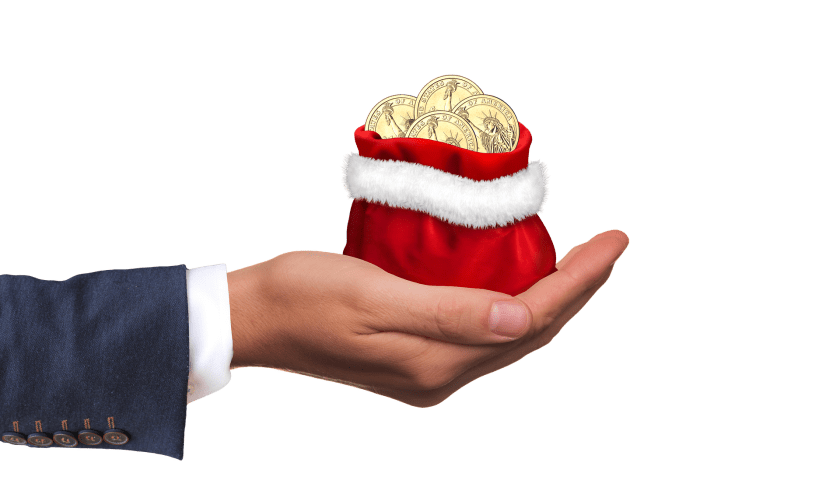 Hand holding a red Santa bag with coins in it