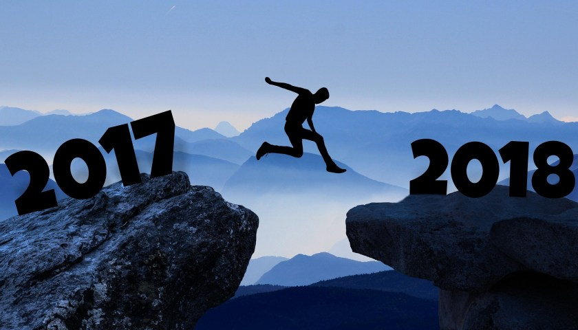 "person jumping over a cliff with ""2017"" on left and ""2018"" on the right"