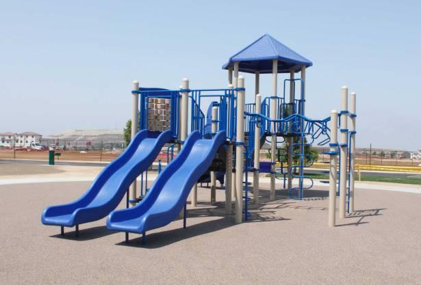 Dual wave slide playground equipment at Saburo Muraoka Elementary School at Chula Vista