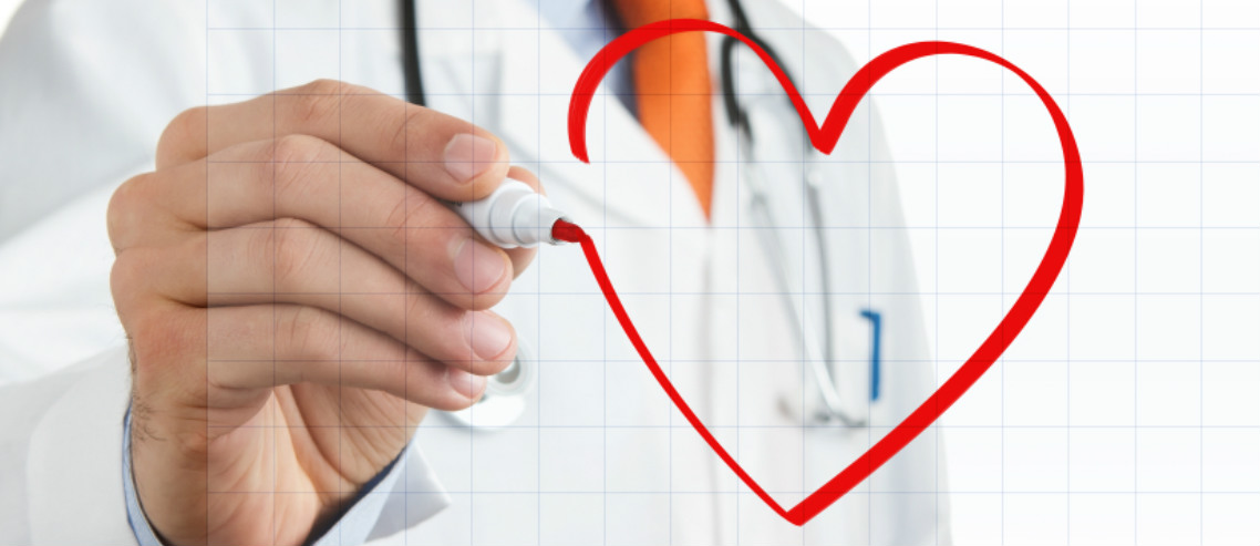 a doctor draws a heart on a window in red pen, illustrating our discussion regarding cardiovascular disease