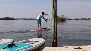 Paddle boarding in a Paddles By The Sea Tshirt